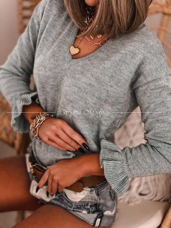 Sweterek falbanami gris